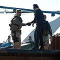 US Navy 070104-N-9268E-001 A Commander Task Group (CTG) 158.1 boarding team member takes time to introduce himself to a local mariner operating in the North Arabian Gulf.jpg