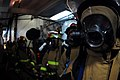 US Navy 070326-N-9928E-120 Damage Controlman 3rd Class Jesse Minor along with fellow Sailors assigned to the flying squad aboard Nimitz-class aircraft carrier USS John C. Stennis (CVN 74) participate in a mass casualty drill.jpg