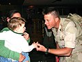 US Navy 070328-N-5324B-002 Builder 1st Class Eric Files and greets his 19-month old son at the Eugene Airport in Oregon upon return from a 10-month deployment in Iraq.jpg