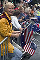US Navy 070425-N-5253W-002 An Australian woman waves American and Australian flags as USS Lassen (DDG 82) Sailors march by during the Australia-New Zealand Army Corps (ANZAC) Day Parade.jpg