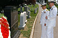 US Navy 070516-N-1134L-005 Japanese Maritime Self Defense Force Chief of Naval Operations Adm. Eiji Yoshikawa, left, and Rear Adm. James D. Kelly, commander, U.S. Naval Forces, Japan, pays their respects.jpg