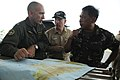 US Navy 080626-N-4009P-040 Rear Adm. James P. Wisecup, Brig. Gen. Jorge Segovia, and Capt. Thomas P. Lalor discuss the current relief efforts.jpg