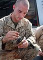 US Navy 081028-N-6764G-076 Lance Cpl. Matt Dillman loads a clip during a live fire exercise.jpg