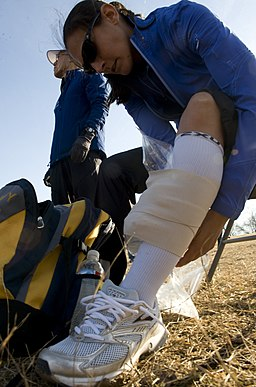US Navy 090207-N-7090S-066 Lt. j.g. Gina Shaw treats shin splints by wrapping her leg in ice after her 8 Kilometer run after competing in the 2009 Armed Forces Cross Country Championship