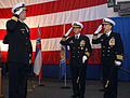 US Navy 090218-N-2984R-042 Capt. Joseph Clarkson and Capt. Herm Shelanski salute Rear Adm. (sel) Mark Fox.jpg