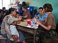 US Navy 090401-N-1580K-562 Navy nurse Capt. Anne White and Honduran translator Sheila Garcia explain medical procedures to villagers from Aguacatal during the Beyond the Horizon humanitarian assistance exercise in Honduras.jpg