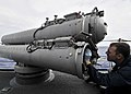 US Navy 090529-N-2638R-002 Gunner's Mate 2nd Class Justin Headley, from Vashon, Wash., conducts preventative maintenance on a MK 32 surface vessel torpedo tube aboard the Arleigh Burke-class guided-missile destroyer USS Mustin.jpg