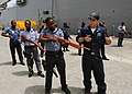 US Navy 100315-N-6676S-099 Electronics Technician 2nd Class Corey Brown works with Ghana navy Lt. j.g. Frank Boateng during an Africa Partnership Station West civil disturbance training class.jpg