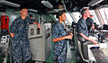 US Navy 100318-N-7058E-062 Cmdr. Randy Garner, commanding officer of the littoral combat ship USS Freedom (LCS 1), looks on as Lt. Cmdr. Jaime Hill and Lt. Todd Sehl maneuver the ship out of the port of Colon.jpg