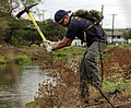 US Navy 100417-N-7498L-614 Master-at-Arms 2nd Class Ingellis Vincent, assigned to Joint Base Pearl Harbor-Hickam, clears weeds at the Kapakahi Stream.jpg