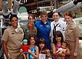 US Navy 100626-N-8913R-145 Girls and female Sailors serving as mentors and role models pose for a photo during the.jpg