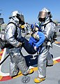 US Navy 100829-N-2686K-062 Sailors assigned to the air department crash and salvage division aboard the aircraft carrier USS George H.W. Bush (CVN 77) simulate an extraction of a Sailor.jpg