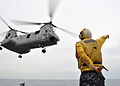 US Navy 101108-N-3620B-022 Aviation Support Equipment Technician 2nd Class Dean McRae signals for a CH-46E Sea Knight helicopter assigned to the F.jpg