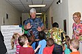 US Navy 110404-N-DD445-003 Capt. Douglas F. Cochrane, commanding officer of Naval Station Mayport, high-fives children after signing.jpg