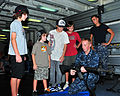 US Navy 110609-N-BT122-493 Gunner's Mate 2nd Class Michael Zimmerman explains firearm function and safety to guests embarked for a Friends and Fami.jpg