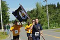 US Navy 110703-N-GA722-127 Cmdr. John L. Bub leads the way carrying the ship's colors during a 7-mile run as part of Maine's largest annual Indepen.jpg