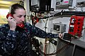 US Navy 110708-N-WH671-004 Information Systems Technician Seaman Samantha Myhre performs a communications check in the main communications work cen.jpg