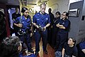 US Navy 110711-N-RC734-017 Damage Controlman 2nd Class Doug Newland, center, trains Sailors how to properly operate a self-contained breathing appa.jpg