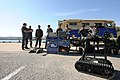 US Navy 111024-N-LW591-146 Sailors assigned to Explosive Ordnance Disposal Mobile Unit (EODMU) 6 demonstrate the Talon Robot to members of the Aust.jpg