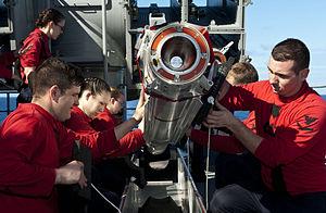 US Navy 120214-N-VH839-016 ailors aboard the Nimitz-class aircraft carrier USS John C. Stennis (CVN 74) remove a RIM-7 Sea Sparrow missile from a N.jpg