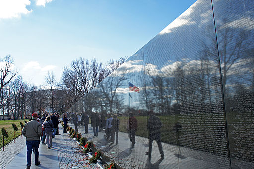 US flag reflexion on Vietnam Veterans Memorial 12 2011 000124