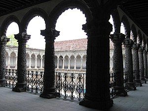 La Merced Cloister - View of patio from behind columns of the upper floor