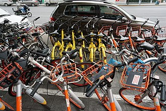 Bicycle-sharing systems, such as ofo (yellow) and Mobike (orange), are common in Shanghai. Various bike-share bikes in china.jpg