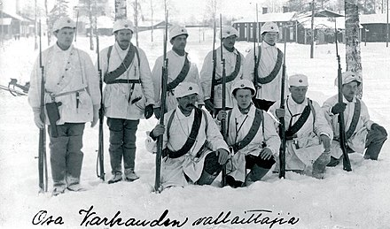 Members of the White Guard after the Battle of Varkaus. The White Guard was a voluntary militia that fought for the Whites in the Finnish Civil War. Varkaus White Guards 1918.jpg