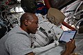 Victor Glover works on US spacesuit maintenance inside the Quest airlock 02.jpg