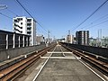 View from platform of Kyudai-Gakkentoshi Station.jpg