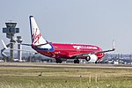 Virgin Australia (VH-VUX) Boeing 737-8FE(WL) taking off on runway 25 at Sydney Airport.jpg
