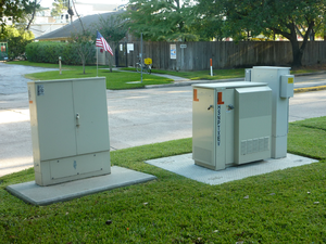 Video-ready access device - Cross-connect box (left) and VRAD (right) on a suburban street in Houston, Texas.