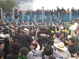Criticism of the World Trade Organization - Protestors clashing with Hong Kong police in the Wan Chai waterfront area during the WTO Ministerial Conference of 2005.