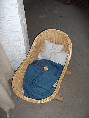 Bassinet - Modern reproduction of a medieval cot and rattle, c. 1465