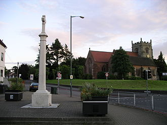 Walsgrave - The 1914–1918 war memorial with St Mary's Church in the background