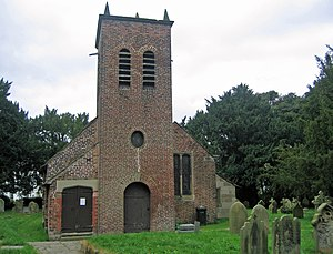 St Werburgh's Church, Warburton - East elevation of the brick tower added to the east end in 1711