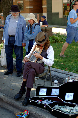 Washboard (musical instrument) - Busking on a washboard.