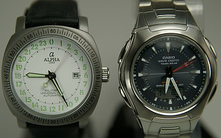 "Different kinds of movements move the hands differently as shown in this 2-second exposure. The left watch has a 24-hour analog dial with a mechanical 1/6 s movement, the right one has a more common 12-hour dial and a ""1 s"" quartz movement Watch Mechanical Quartz Comparison.jpg"