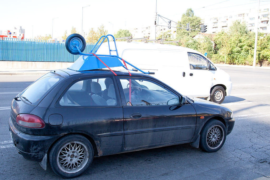 Roof Rack For Cars >> File:Wheelbarrow on car roof without roof rack, Sofia 2012 PD 1.jpg - Wikimedia Commons