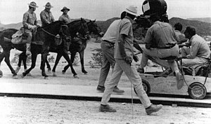 The Wild Bunch - Peckinpah (far right) directs the opening scene as the Bunch ride into Starbuck.