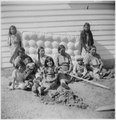 Women and children in front of mattress - NARA - 285244.tif