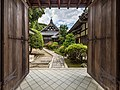 Wooden gate with open double door leading to the garden of Isshinin Buddhist temple in the compounds of Chion-in Kyoto Japan.jpg