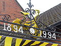 Yellow bicycle on the Long Memorial Hall gates, Spofforth (28th June 2014).JPG