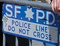 """S.F.P.D. POLICE LINE DO NOT CROSS"" fence sign at 2008 Olympic Torch Relay in SF - Embarcadero 22 (cropped).JPG"