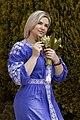 День Вишиванки. Молода україночка у вишитій синій сукні серед квітів 26.jpg