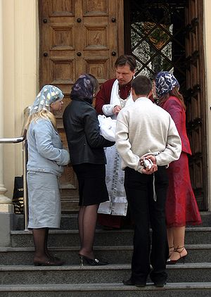 Baptismal clothing - Russian Orthodox priest, parents, godparents and a newly baptized baby.
