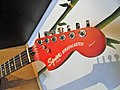 00 Squier Trans Fat Stratocaster headstock in red.jpg