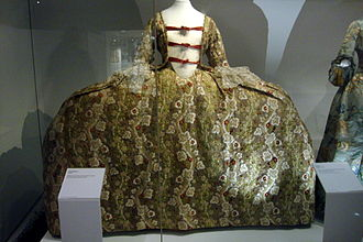 1750–75 in Western fashion - English or French court dress, c. 1760, with wide panniers.  Taken at the Fashion Museum in Bath, England.