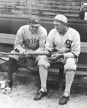 Ruth and Shoeless Joe Jackson looking at one of Babe's home run bats, 1920 1920 Babe Ruth and Shoeless Joe.jpg