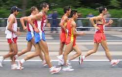 "Men's 20 km walk during the 2005 World Championships in Athletics in Helsinki, Finland.  The man on the far right is illegally ""lifting""."